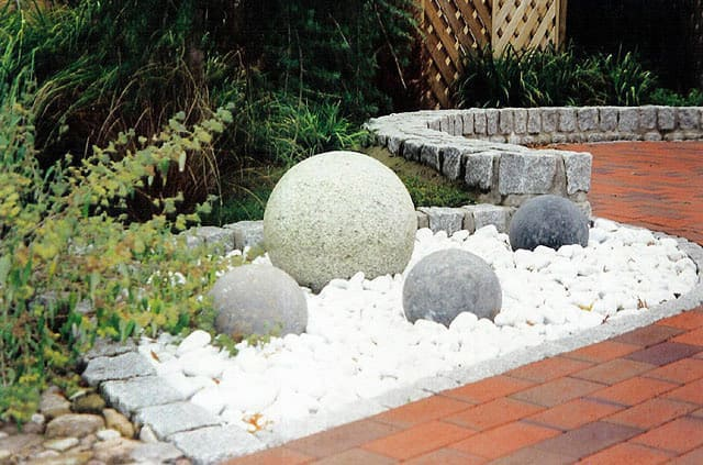 Drainage system with Carrara garden gravel.