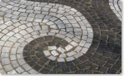 Curved mosaic pavement. Carrara and basalt with permanent joint PF1.