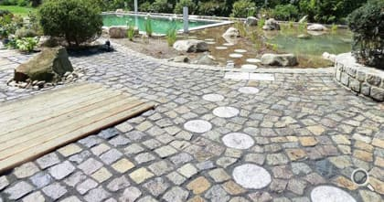 Large stone paving at the swimming pond.