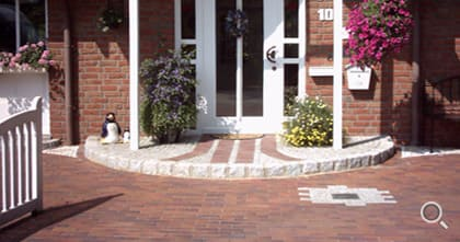 House entrance area with red paving clinker.
