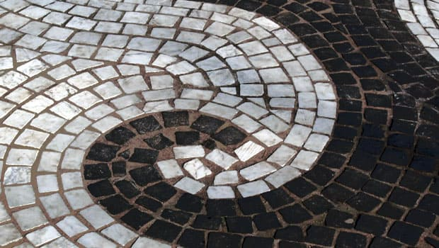 Carrara mosaic pavement with curved design.